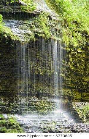 Misty waterfall in gorge.