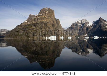Reflection Of Mountain In The Water In Sermilik Fjord