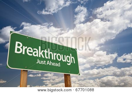 Breakthrough Green Road Sign with Dramatic Clouds and Sky.