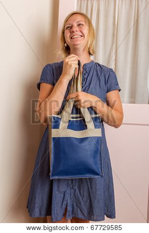 Smiling Blonde Woman With Blue Leather Purse