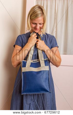 Blonde Woman With Blue Leather Purse