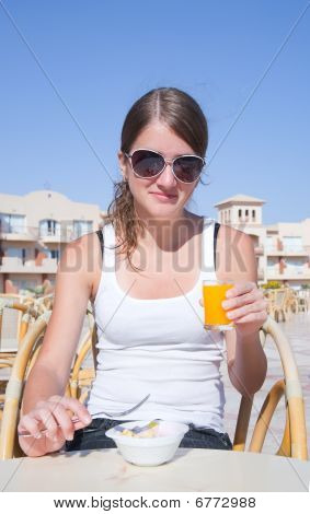 Girl Eating  In Outdoors Cafe