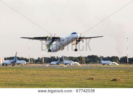 Departing airBaltic De Havilland Canada DHC-8-402Q Dash 8 aircraft
