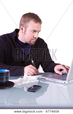 Young Casual Businessman Working At His Desk