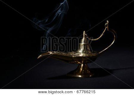 Magic lamp isolated on black