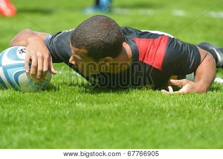 MOSCOW, RUSSIA - JUNE 29, 2014: Pierre Mathurin of Germany with the ball in the match for place 11 with Romania during the FIRA-AER European Grand Prix Series. Germany won 26-12