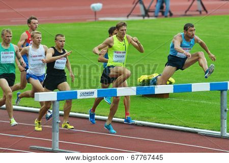 ZHUKOVSKY, MOSCOW REGION, RUSSIA - JUNE 27, 2014: Athletes in men 3000 meters steeplechase during Znamensky Memorial. The competitions is one of the European Athletics Outdoor Classic Meetings