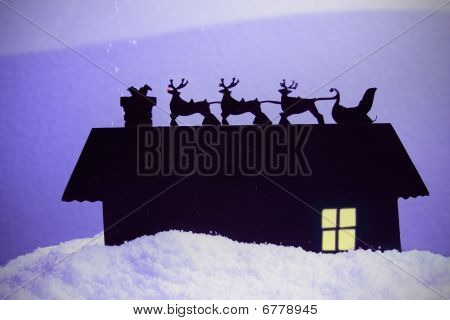 Santa Claus climbing down a chimney
