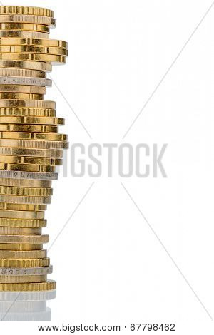 stack of money coins in front of white background, symbol photo for savings, thrift, small savers