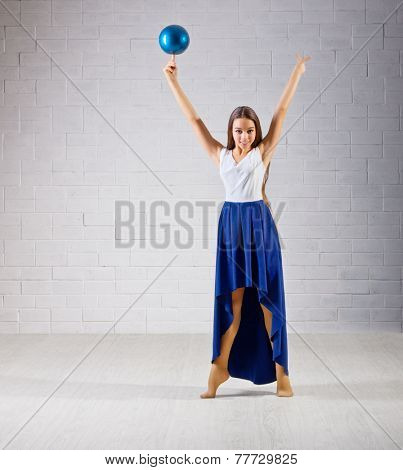 Young girl is engaged in art gymnastics on grey wall (normal ver) poster