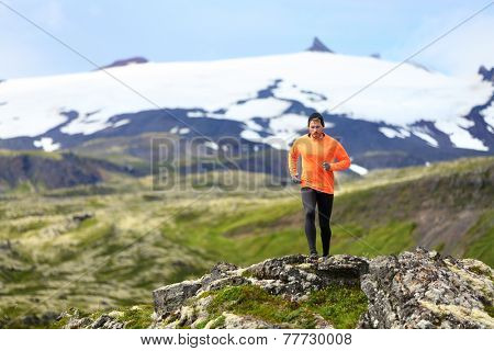 Running man exercising - trail runner athlete. Fit male sport fitness model training and jogging outdoors living healthy lifestyle in beautiful mountain nature, Snaefellsjokull, Snaefellsnes, Iceland. poster