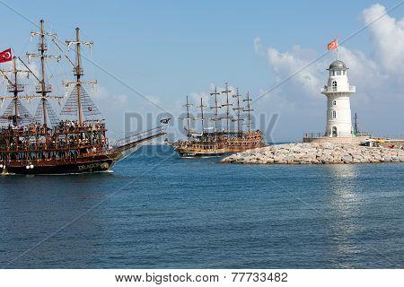 Tourists enjoying sea journey on vintage sailships in Alanya Turkey.