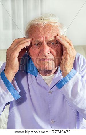 Senior man with headache