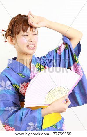 woman wearing Japanese kimono,suffers from intense heat