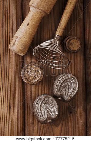 retro kitchen cookies jelly mould utensils tools on old wooden table in rustic style