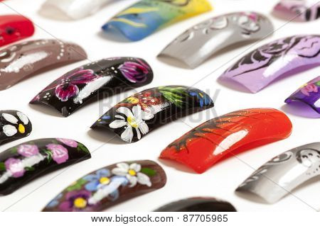 Nail art handmade. Colorful nails isolated on white background