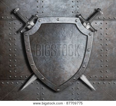 metal shield and two crossed swords over armor plates metal background
