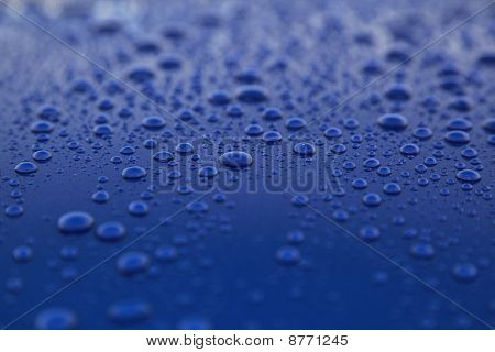 Rain drops on a blue car