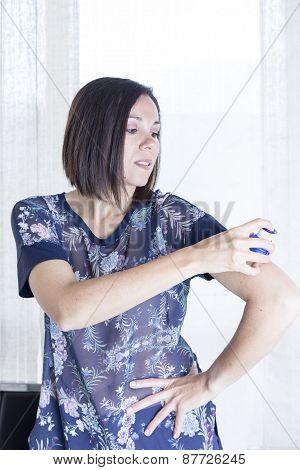 Young Woman Applying The Sensor.
