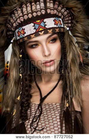 Beautiful ethnic lady with roach on her head.