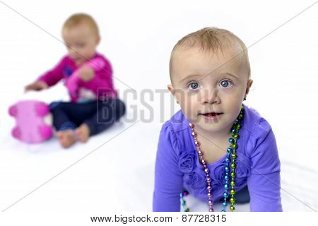 Twelve Month Twin Sisters Playing