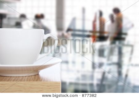 Coffee Cup On Table In Front Of Office