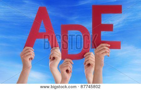 People Holding German Word Ade Means Goodbye Blue Sky