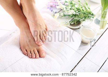 groomed female feet on a white towel poster