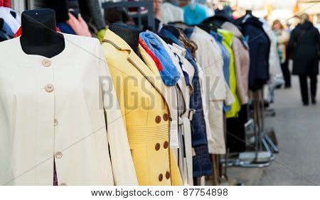 Row Of Mannequins With Different Coloured Women's Clothes On Market
