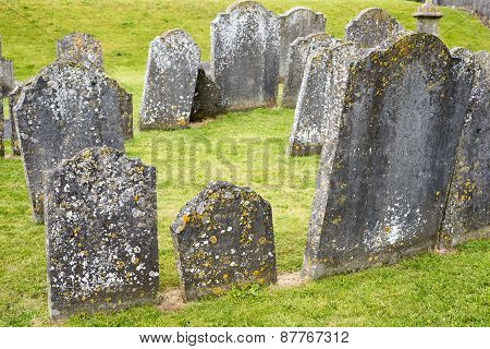 gravestones at ancient graveyard in St Canice's Cathedral in kilkenny city ireland poster