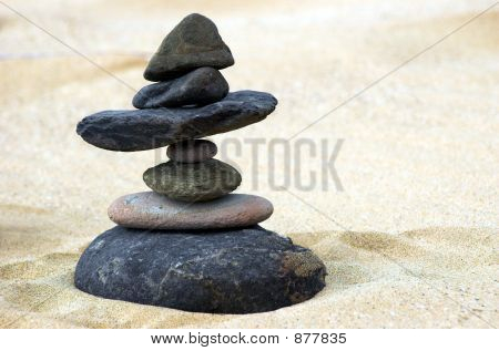 seven stones in perfect balance in beach poster