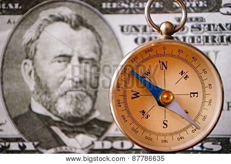 Compass Instrument In Front Of A 50 Us Dollar Bill