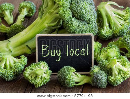 Fresh Broccoli With Small Chalkboard