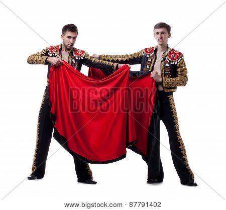 Image of cute guys posing dressed as toreadors