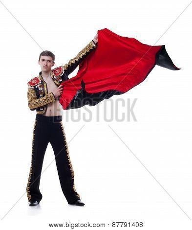 Studio shot of man dressed as bullfighter