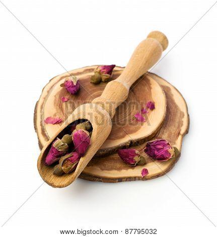 Dry Tea Roses In Wooden Scoop
