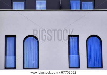 Blue Glass Windows On A Modern Building Wall