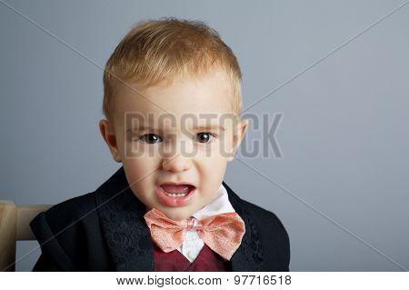little angry gentleman on grey