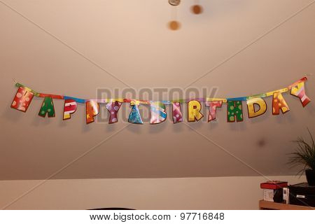 A display showing happy birthday on a waal poster