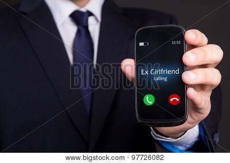 Male Hand Holding Smart Phone With Incoming Call From His Ex Girlfriend