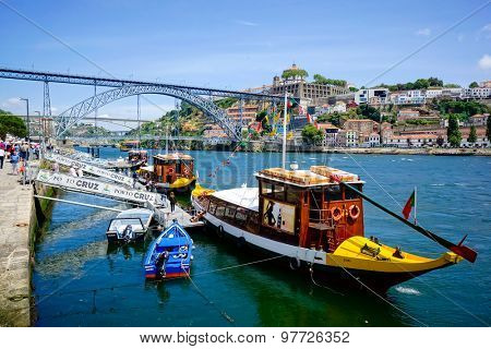 PORTO, PORTUGAL - JUNE, 11: Tourist boats wait for passengers at the pier near famous landmark Luis bridge at day time on June 11, 2015 in Porto, Portugal