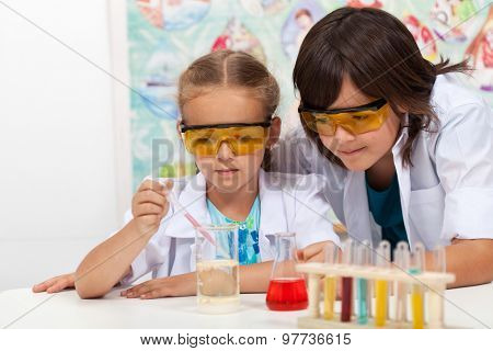 Young students in chemistry class - doing the chemical yoyo experiment