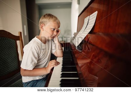 boy plays piano at home