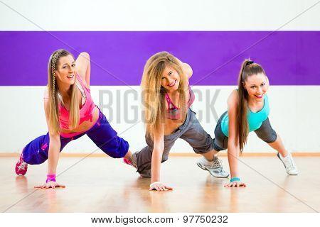 Young zumba women dancing modern group choreography in dance school