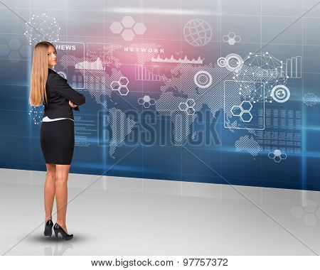 Businesslady looking at camera, rear view