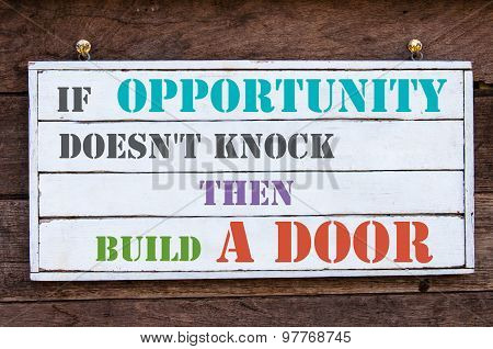 If Opportunity Doesn't Knock Then Build A Door Inspirational message written on vintage wooden board. Motivation concept image poster