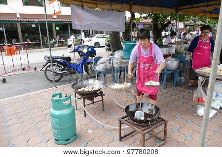The Woman Is Frying Pork Ball In The Pan
