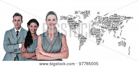 Happy business team smiling at camera against world map of buzzwords