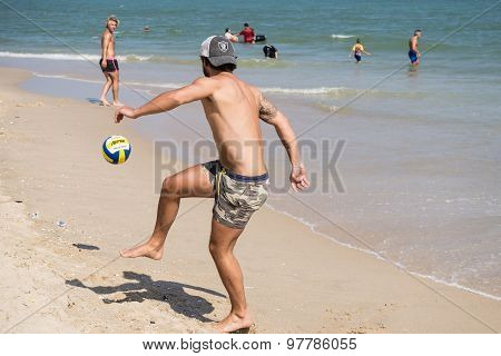 Tourists Playing With Ball On The Beach