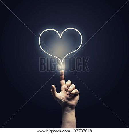 Male hand touch heart pulse on futuristic interface
